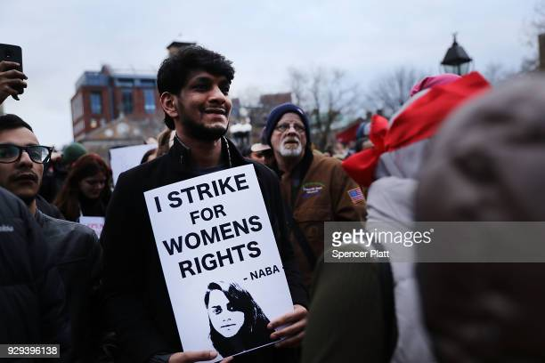 Dozens of women and men attend a rally and march in Washington Square Park for international Women's Day on March 8, 2018 in New York City. Around...