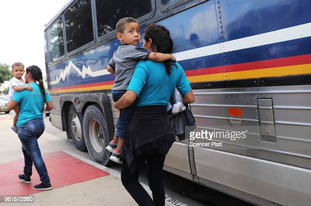Dozens of women and their children, many fleeing poverty and violence in Honduras, Guatamala and El Salvador, arrive at a bus station following...