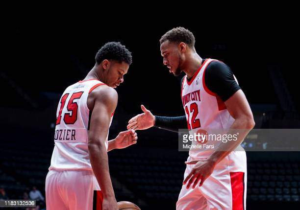 Dozier and Daniel Gafford of the Windy City Bulls celebrate after hitting basket against the Long Island Nets during an NBA G-League game on November...