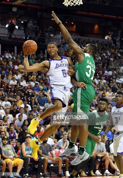 J Dozier of the Los Angeles Lakers drives to the basket against Semi Ojeleye of the Boston Celtics during the 2017 Summer League at the Thomas Mack...