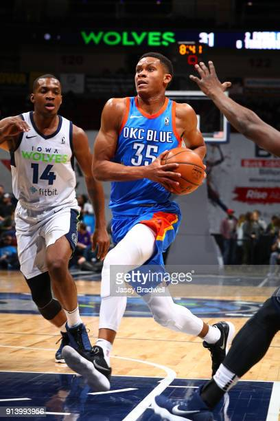 Dozier of the Oklahoma City Blue drives past Elijah Millsap of the Iowa Wolves in an NBA GLeague game on February 3 2018 at the Wells Fargo Arena in...