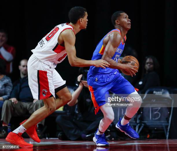 Dozier of the Oklahoma City Blue goes to the basket against Tyler Harris of the Windy City Bulls during the second half of an NBA GLeague game on...