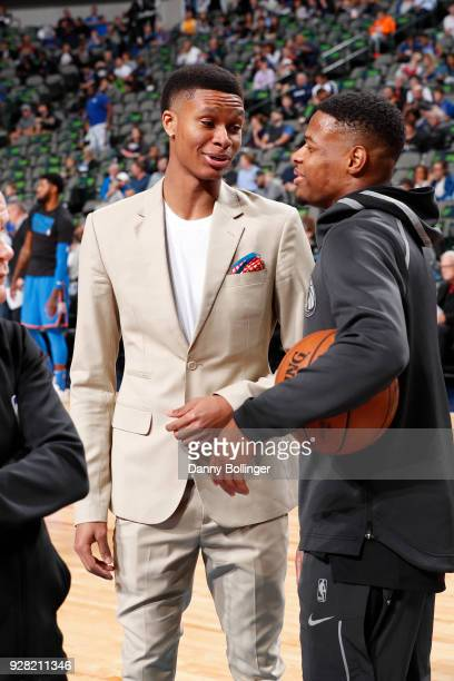 Dozier of the Oklahoma City Thunder talks with Dennis Smith Jr #1 of the Dallas Mavericks prior to the game between the two teams on February 28 2018...