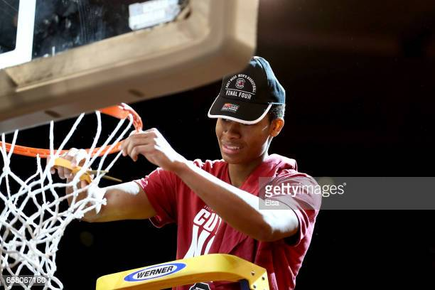 Dozier of the South Carolina Gamecocks celebrates by cutting down the net after defeating the Florida Gators with a score of 77 to 70 to win the 2017...