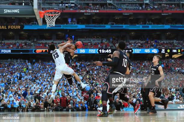 Dozier of the South Carolina Gamecocks goes up with the ball against Josh Perkins of the Gonzaga Bulldogs in the second half during the 2017 NCAA...