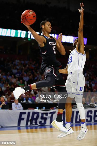 Dozier of the South Carolina Gamecocks looks to pass the ball against Matt Jones of the Duke Blue Devils in the first half during the second round of...