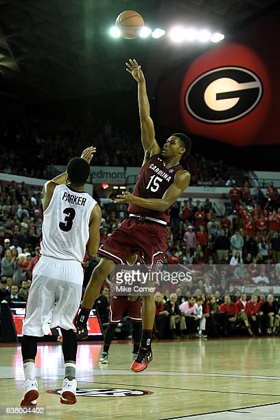 Dozier of the South Carolina Gamecocks shoots over Juwan Parker of the Georgia Bulldogs at Stegeman Coliseum on January 4 2017 in Athens Georgia