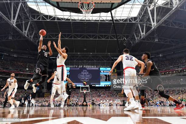 Dozier of the South Carolina Gamecocks takes a jumpshot over Silas Melson of the Gonzaga Bulldogs during the 2017 NCAA Men's Final Four Semifinal at...