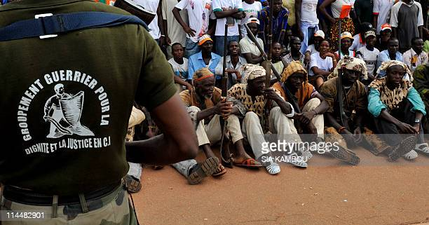 Dozo men traditional hunters from northern Ivory Coast sit as they attend the investiture ceremony of Ivory Coast President Alassane Ouatarra at the...