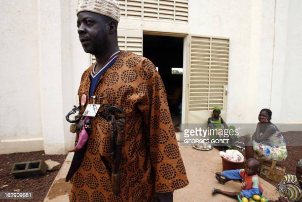 A Dozzo hunter leaves a debate 06 June 2007 in Sikasso a Malian town 370 kms south of Bamako for what is dubbed a summit of the poor About 1000...