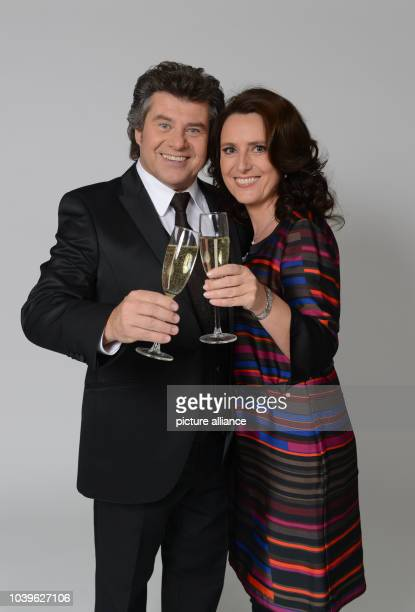 dpaExclusive Austrian television presenter and singer Andy Borg and his wife Birgit cheer with a glas of sparkling wine during a rehearsal for the...