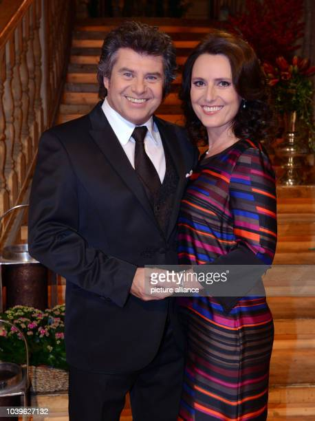 dpaExclusive Austrian television presenter and singer Andy Borg and his wife Birgit smile and pose during a rehearsal for the ARDtelevision music...
