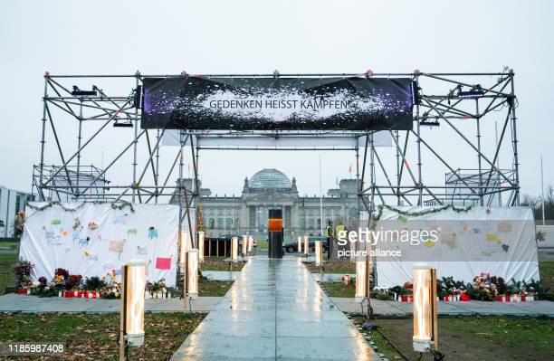 A column into which the ashes of Auschwitz victims are said to have been poured stands in front of the Reichstag The object is part of an artwork of...