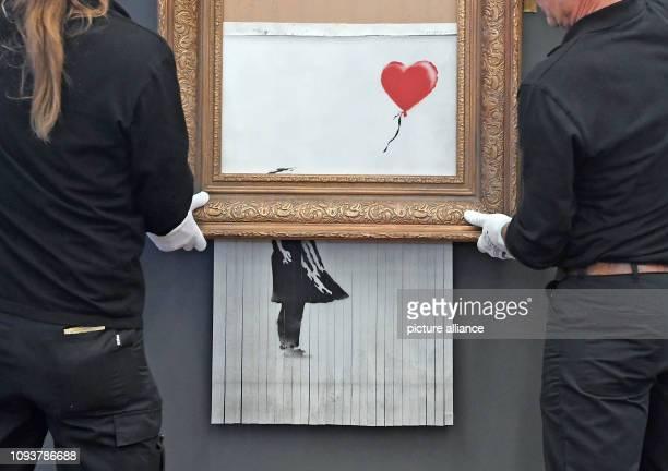 dpatop 04 February 2019 BadenWuerttemberg BadenBaden The shredded Banksy painting 'Love is in the Bin' is hung in the Frieder Burda Museum The work...
