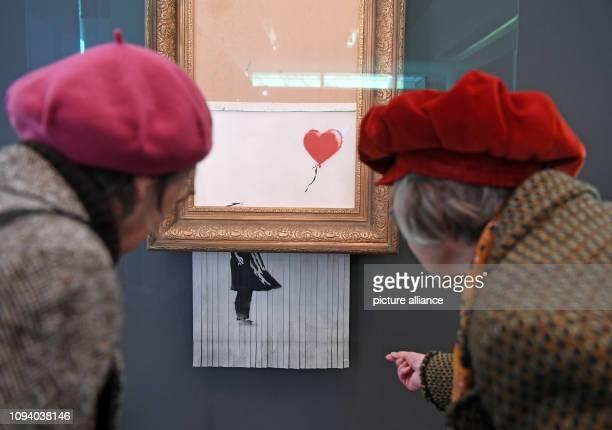 dpatop 05 February 2019 BadenWuerttemberg BadenBaden Visitors look at the shredded Banksy painting 'Love is in the Bin' in the Frieder Burda Museum...