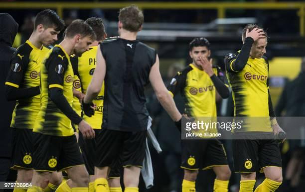 dpatop 08 March 2018 Germany Dortmund Europa League match between Borussia Dortmund and RB Salzburg Signal Iduna Park Dortmund's players with Marco...