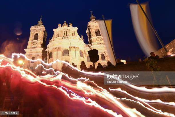 dpatop 10 May 2018 Germany Weingarten Numerous people walk pass the basilica during a candlelight procession Only light strips can be seen due to the...