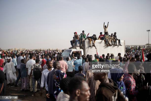 Sudanese demonstrators celebrate the arrest of longtime President Omar alBashir by the armed forces outside the Defence Ministry People continue to...