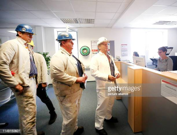 dpatop 11 June 2019 North RhineWestphalia Bottrop The miners Michael Ludwig Andreas Bossenheiff and Elmar Hammerschmidt who have been dismissed by...
