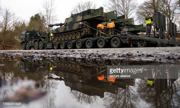 dpatop 12 February 2020 Lower Saxony Bergen An M109A6 selfpropelled howitzer of the US Army is loaded onto a Bundeswehr heavyduty transporter during...