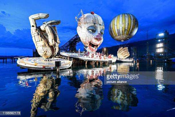 """Dpatop - 12 July 2019, Austria, Bregenz: A scene from Verdi's opera """"Rigoletto"""" during photo rehearsal on the lake stage as part of the Bregenz..."""
