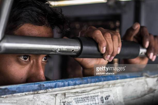 dpatop 13 April 2018 Mexico MexicoCity A man holds on to a bar of a vehicle which is meant to bring him and and a group of migrants from Central...