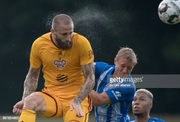 dpatop 13 July 2018 Neuruppin Germany Test match Hertha BSC Dukla Prague Hertha's Per Skjelbred plays against Prague's Jan Holenda Photo Soeren...