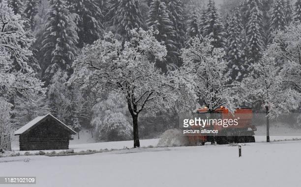 dpatop 13 November 2019 Bavaria GarmischPartenkirchen A snowplough is on the road in winter Photo Angelika Warmuth/dpa