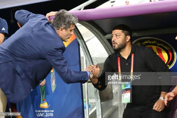 dpatop 15 December 2018 United Arab Emirates Al Ain Al Ain FC head coach Zoran Mamic and ES Tunis head coach Mouine Chaaban shake hands prior to the...