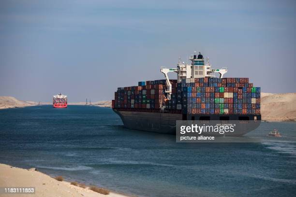 Dpatop - 17 November 2019, Egypt, Ismailia: Container ships sail in Suez Canal, during the 150th anniversary of the Suez Canal. Photo: Gehad Hamdy/dpa
