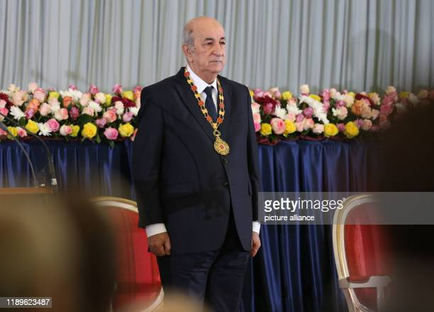 dpatop 19 December 2019 Algeria Algiers Algerian President Abdelmadjid Tebboune stands after his swearingin ceremony Photo Farouk Batiche/dpa