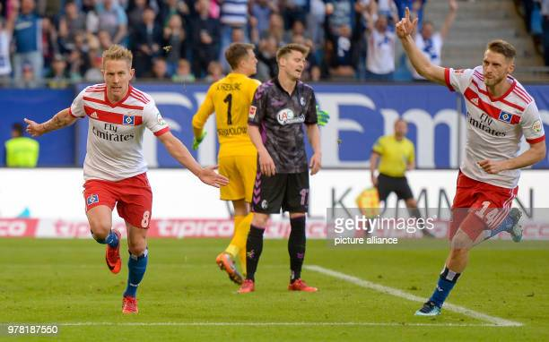 Football German Bundesliga Hamburg SV vs SC Freiburg at the Volksparkstadion Hamburg's Lewis Holtby and Hamburg's Aaron Hunt celebrate after the goal...