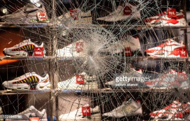 Dpatop - 21 June 2020, Baden-Wuerttemberg, Stuttgart: The shop window of a shop for shoes in Königstraße is badly damaged. Several people were...