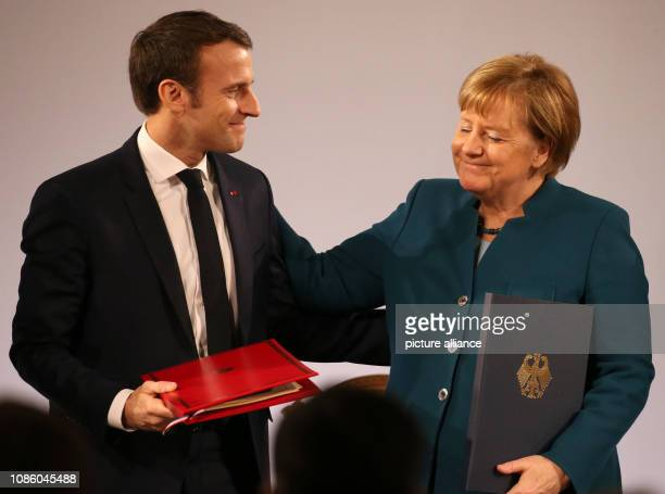 dpatop 22 January 2019 North RhineWestphalia Aachen Emmanuel Macron President of France and Chancellor Angela Merkel after the signing of the treaty...