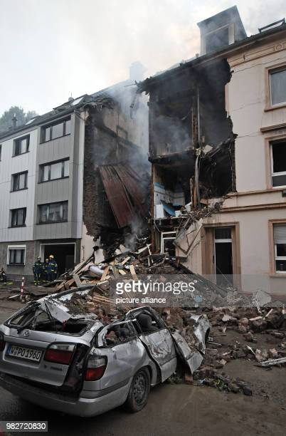 dpatop 24 June 2018 Wuppertal Germany Debris of a house in which there was an explosion at night lie on the street In an explosion in a residential...