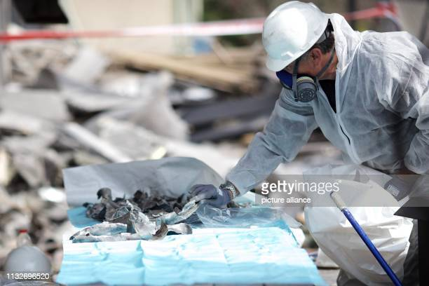 A forensic officer collects evidences at a damaged house after it was hit by a rocket in the community of Mishmeret Seven people were injured by a...