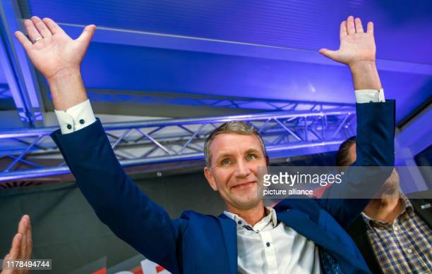 Dpatop - 27 October 2019, Thuringia, Erfurt: Björn Höcke, top candidate of the AfD in the state election in Thuringia, is celebrated by his...