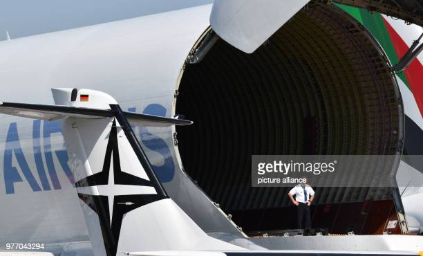 dpatop 28 April 2018 Germany Schoenefeld A man standing in the cargo hold of an Airbus 'Beluga' at the ILA 2018 In the background is a Boeing 7478...