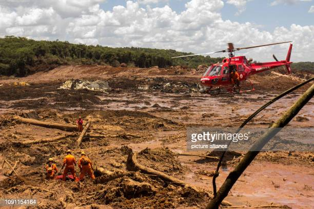 dpatop 29 January 2019 Brazil Brumadinho Firefighters recover a body with the help of a helicopter Helpers search the mud for victims and possibly...