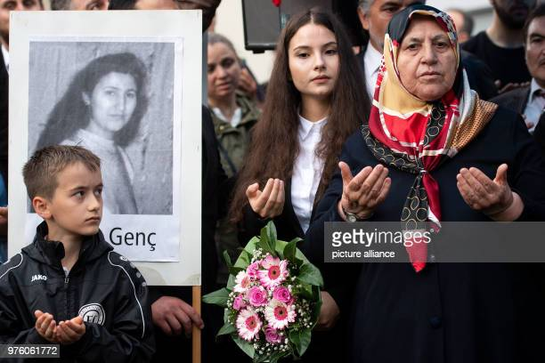 Mevlude Genc and her granddaughter Ozlem Genc participate in the prayer at the place of the arson attack 25 years after the racially motivated arson...
