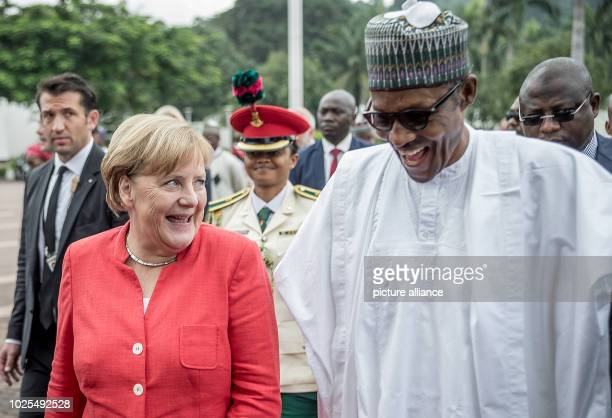 German Chancellor Angela Merkel walks beside Muhammadu Buhari President of the Federal Republic of Nigeria after the welcome Nigeria is the last stop...