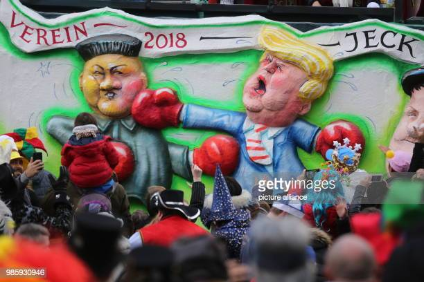 dpatop A caricature float featuring a figure of US President Donald Trump punching North Korean leader Kim Jongun is seen during the annual Rose...