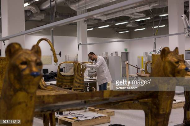 dpatop A conservator works on the restoration of an ancient Egyptian artifact at the Grand Egyptian Museum in Giza Egypt 26 April 2018 Photo Gehad...
