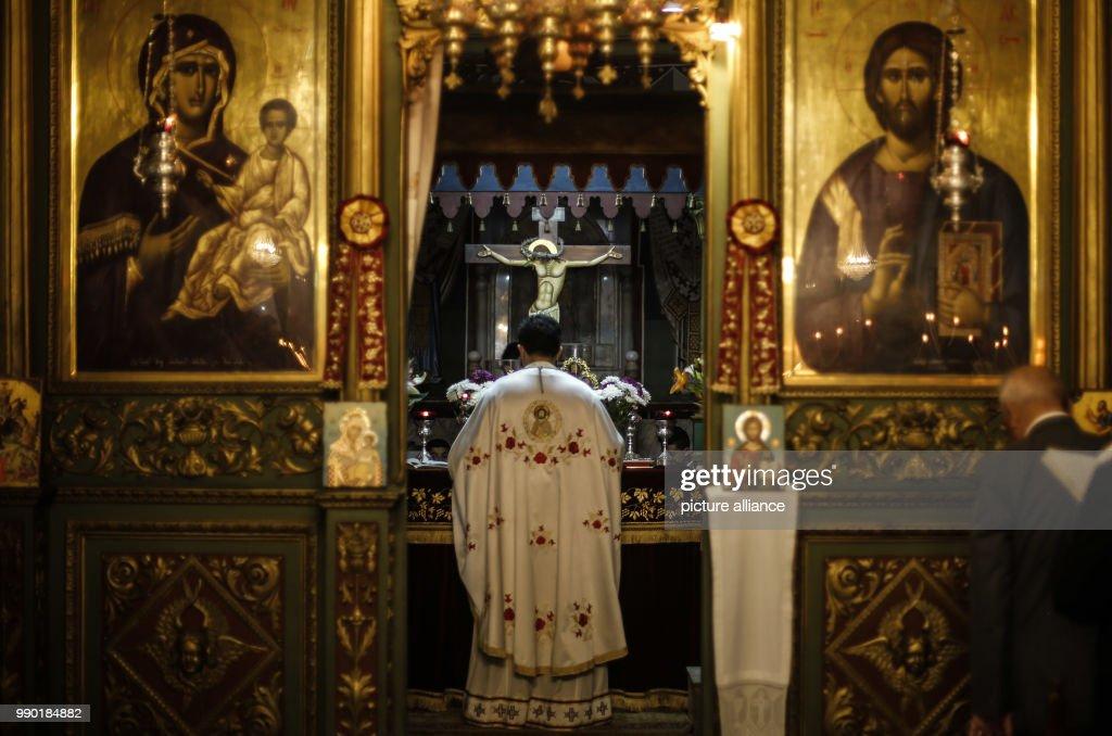 Greek Orthodox Christmas.Dpatop A Greek Orthodox Priest Prays During The Orthodox