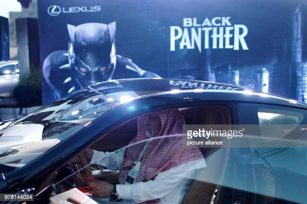 dpatop A man ispects a Lexus car similar to that used in Marvel's superhero movie Black Panther during the opening of the AMC Entertainment cinema...