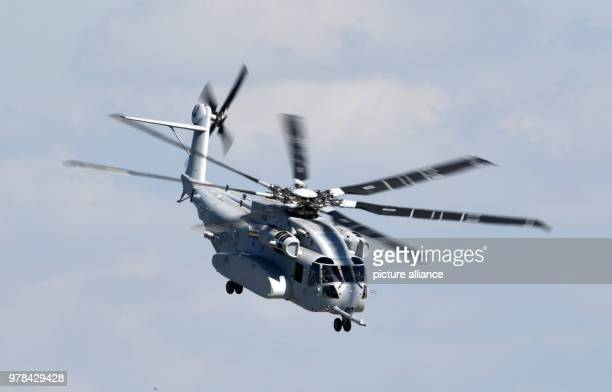 dpatop A Sikorsky CH53 Sea Stallion helicopter performs a flyby during the 2018 Berlin International Air Show in Schoenefeld Germany 25 April 2018...