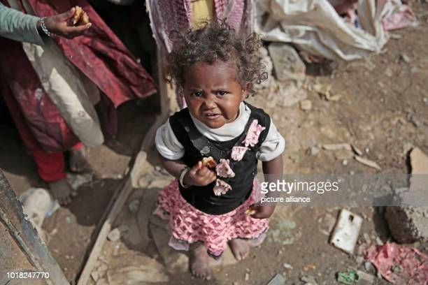 dpatop A Yemeni girl who was displaced from the coastal city of Al Hudaydah stands at the door of a shelter where she lives with her family in Sanaa...