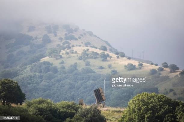 Dpatop - An Israeli Iron Dome rocket defense system is deployed near the border with Syria, in Golan Heights, Israel, 09 May 2018. Israel's army is...