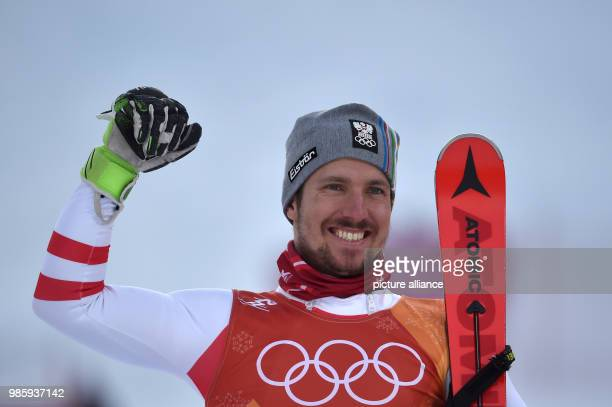 dpatop Austria's Marcel Hirscher celebrates winning the Men's combined alpine skiing event on day four of the Pyeongchang 2018 Winter Olympics Games...