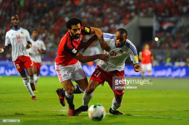 dpatop Egypt national soccer team forward Mohamed Salah battles for the ball during the 2018 World Cup qualifying match against Congo at Borg El Arab...